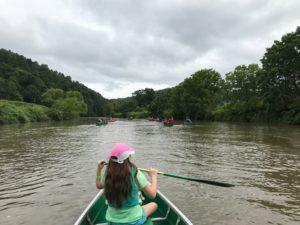kid in a canoe