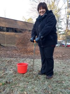 Virginia Lopez demonstrates how to take a proper soil sample with a soil probe.