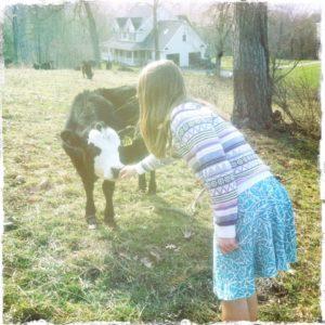 Girl with calf