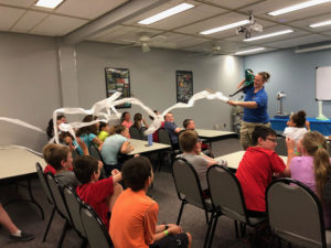 Mandi Williams, deputy director at KidSenses Children's INTERACTIVE Museum in Rutherfordton, N.C., teaches youth at 4-H Science Camp on July 8 about Bernoulli's Principle. 4-H facilitates hands-on learning and promotes the development of life skills.