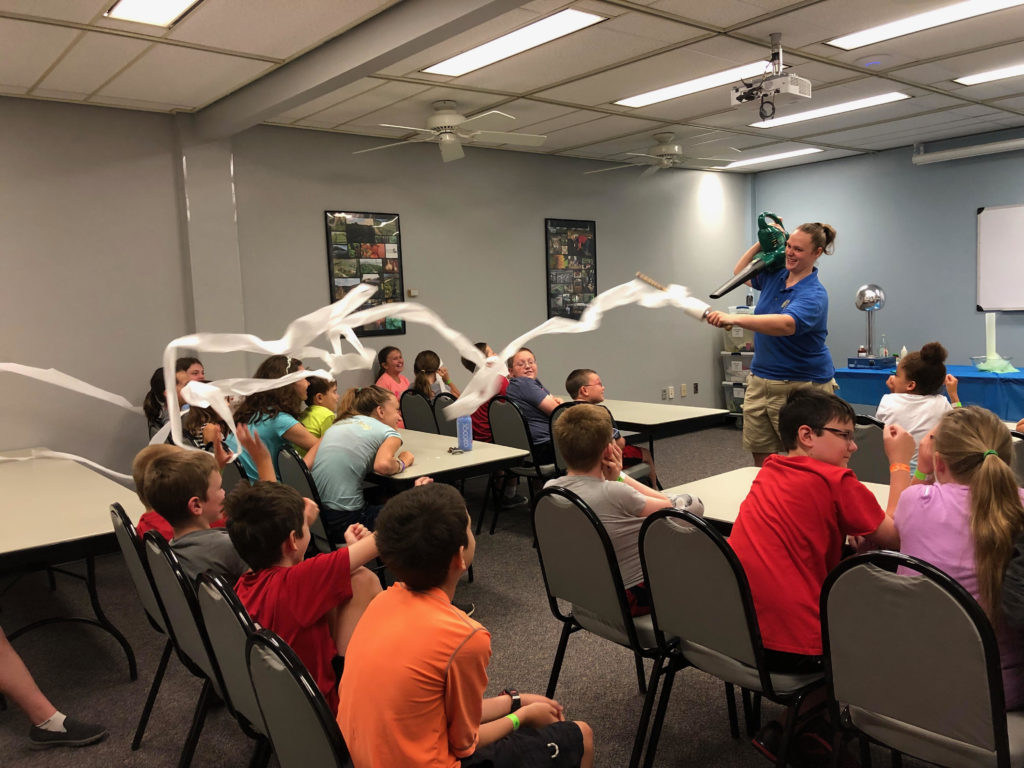 4-H youth participate in Science Camp, which was hosted by the Science 4-H Club during Summer Exploring.