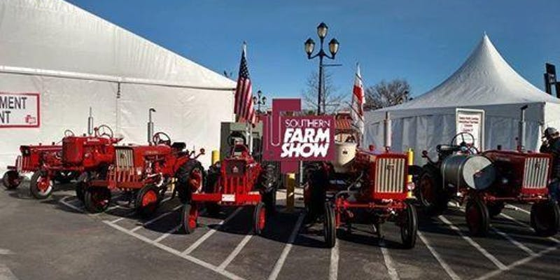 Southern Farm Show picture of red tractors in front of exhibit tents