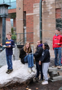-H youth stop to pose on Appalachian State University's campus after a geology field trip. Geologists spoke about their field's work and education during a tour and hands-on laboratory activities.