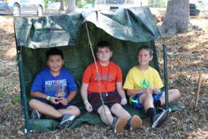 kids under a tarp