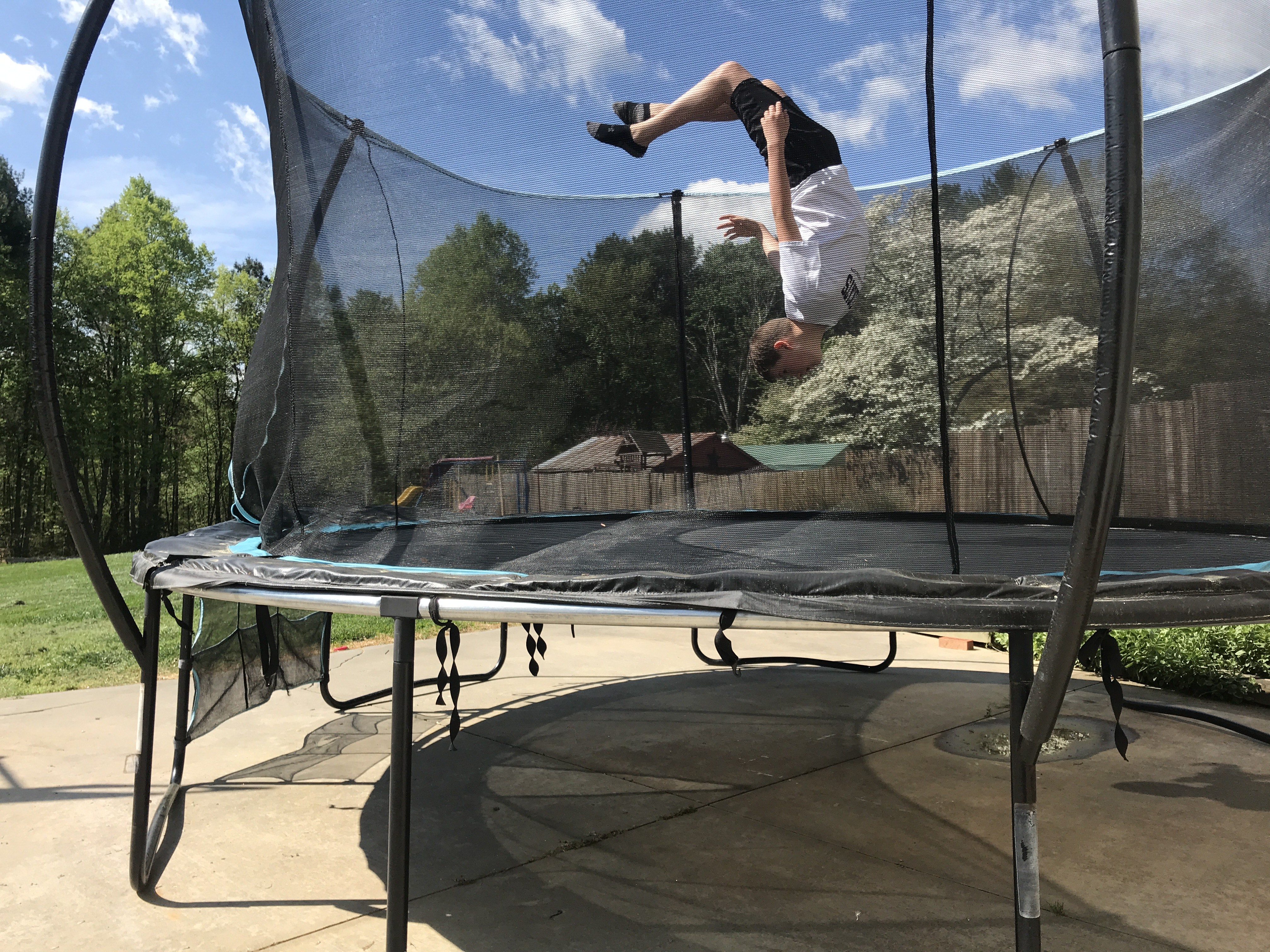 """(Photo by Eli Wingler of Caldwell County): Photography is a hobby and 4-H project that can be done outdoors. Eli Wingler, 8th grade student in Caldwell County, participated in a 4-H photography workshop, """"Focus on Photography,"""" this spring and is pictured jumping on a trampoline outside in his photograph."""