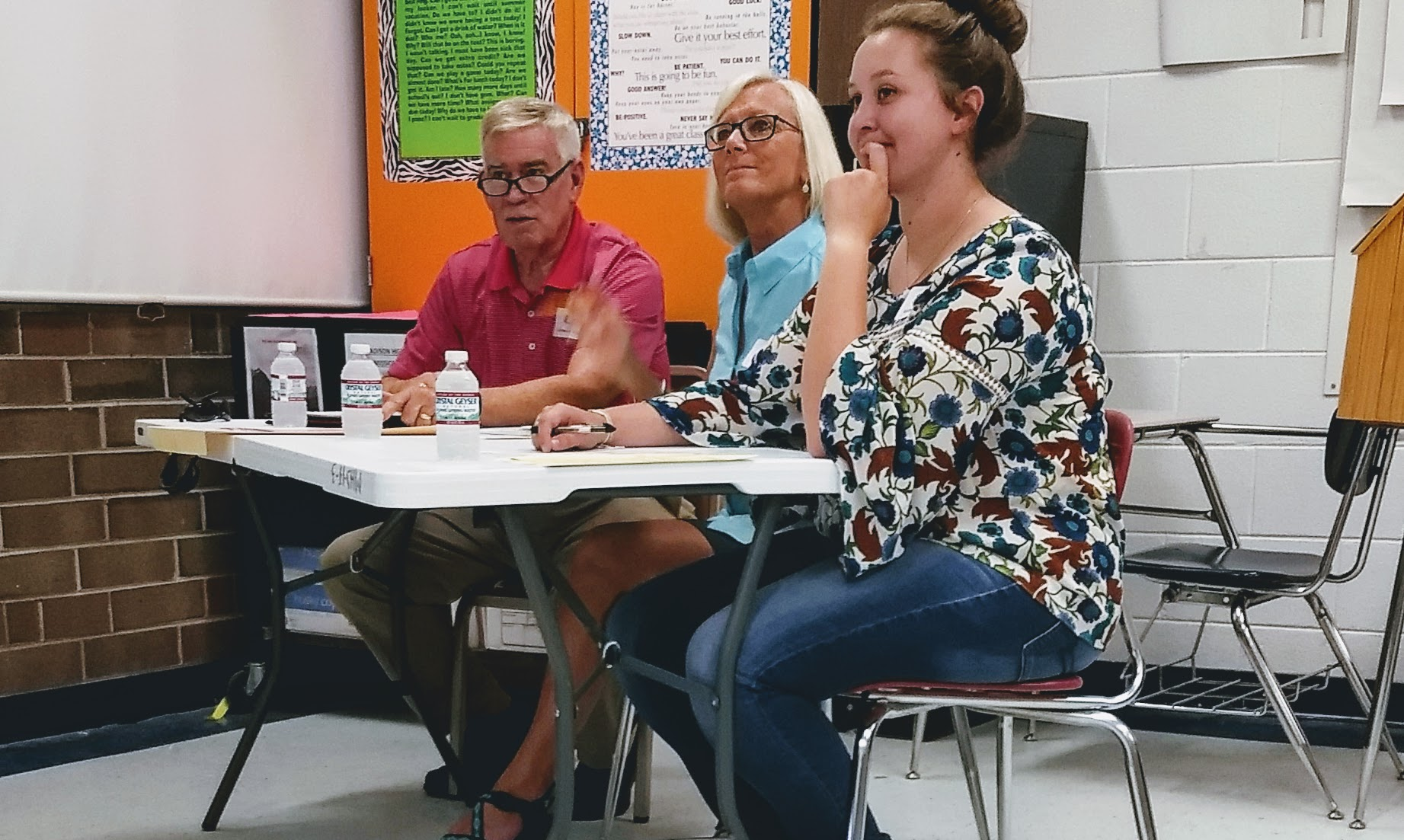 From left to right, Charles Beck, Jackie Nagy and Savannah Sartin judge a local 4-H contest. There are short-term and long-term roles for adults interested in volunteering and supporting youth development.