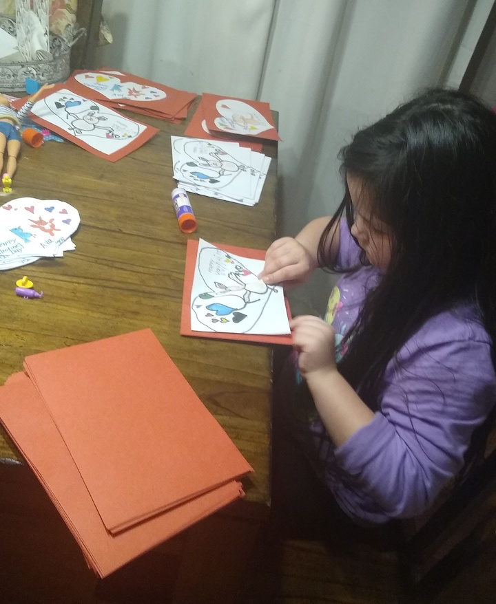 Ava T. works on cards.