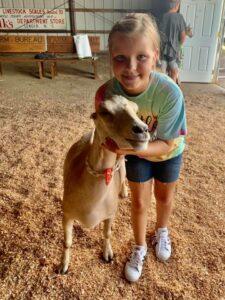 4-H member Peyton practices goat showmanship.