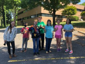 """Participants at Caldwell County 4-H's """"Egg-Cellent Poultry"""" camp pose after an egg and spoon race. In addition to learning about poultry and food science, games were a highlight for youth and teen leaders who attended the program in July 2021."""