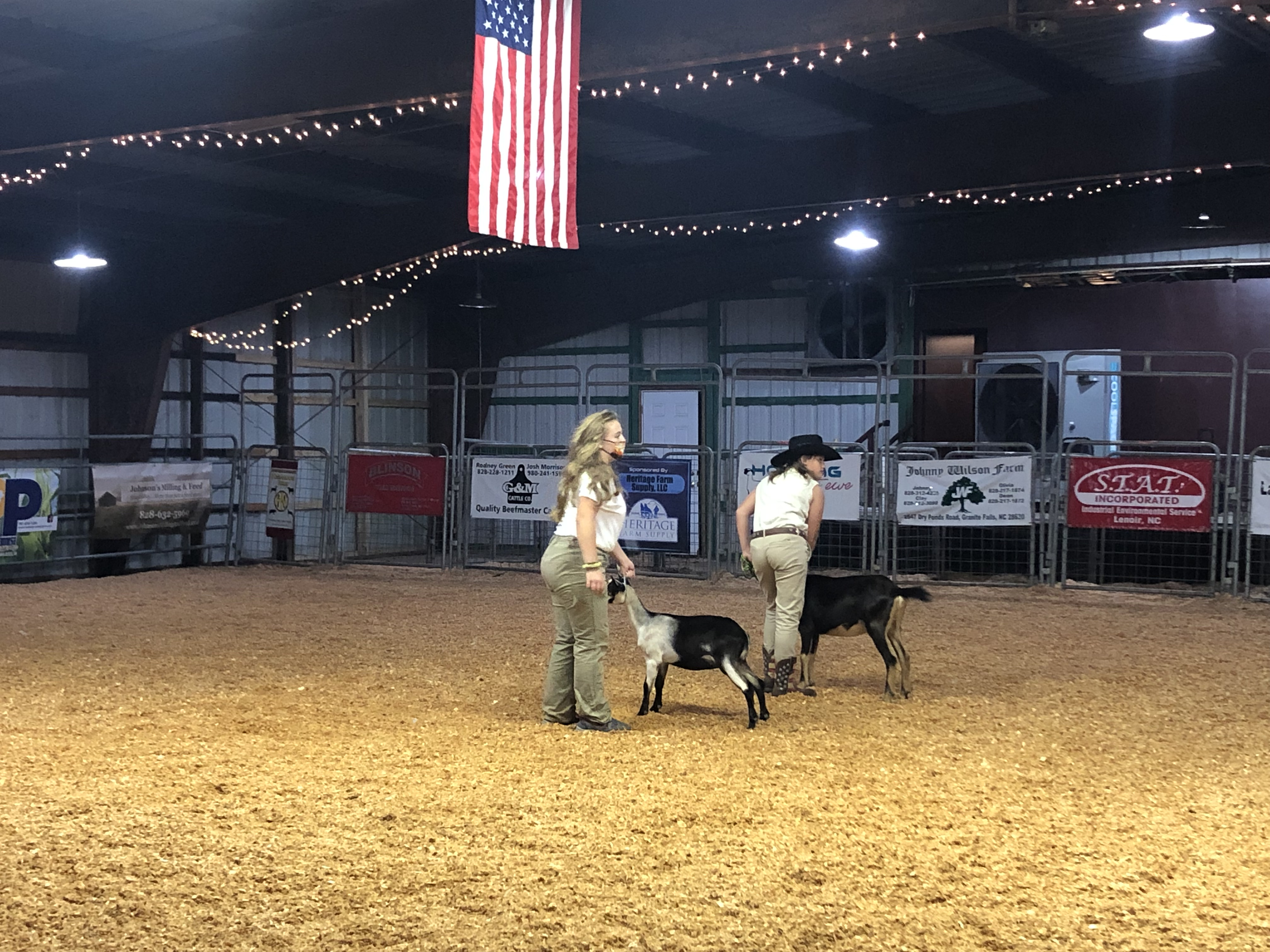 Joselyn White and Alyssa Snyder show their dairy goats at the 2021 fair in Lenoir.