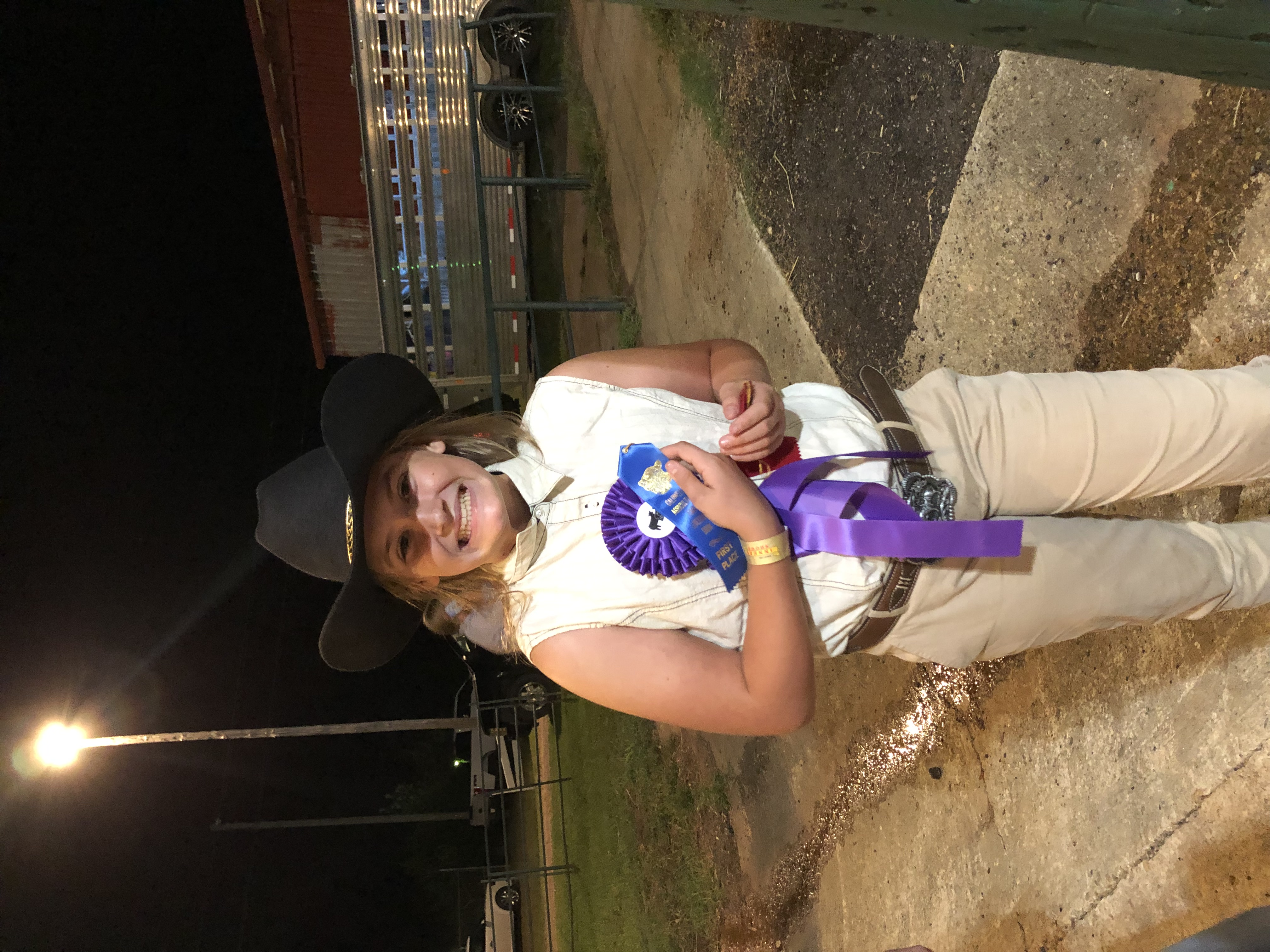 Alyssa Snyder beams after winning the champion dairy goat award at the 2021 fair. This was her first time participating.